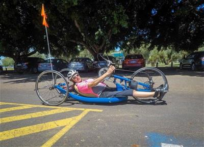 Louise Mofflin riding her handcycle