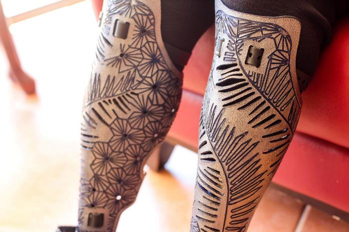 close up of two beautifully patterned leg prosthetics