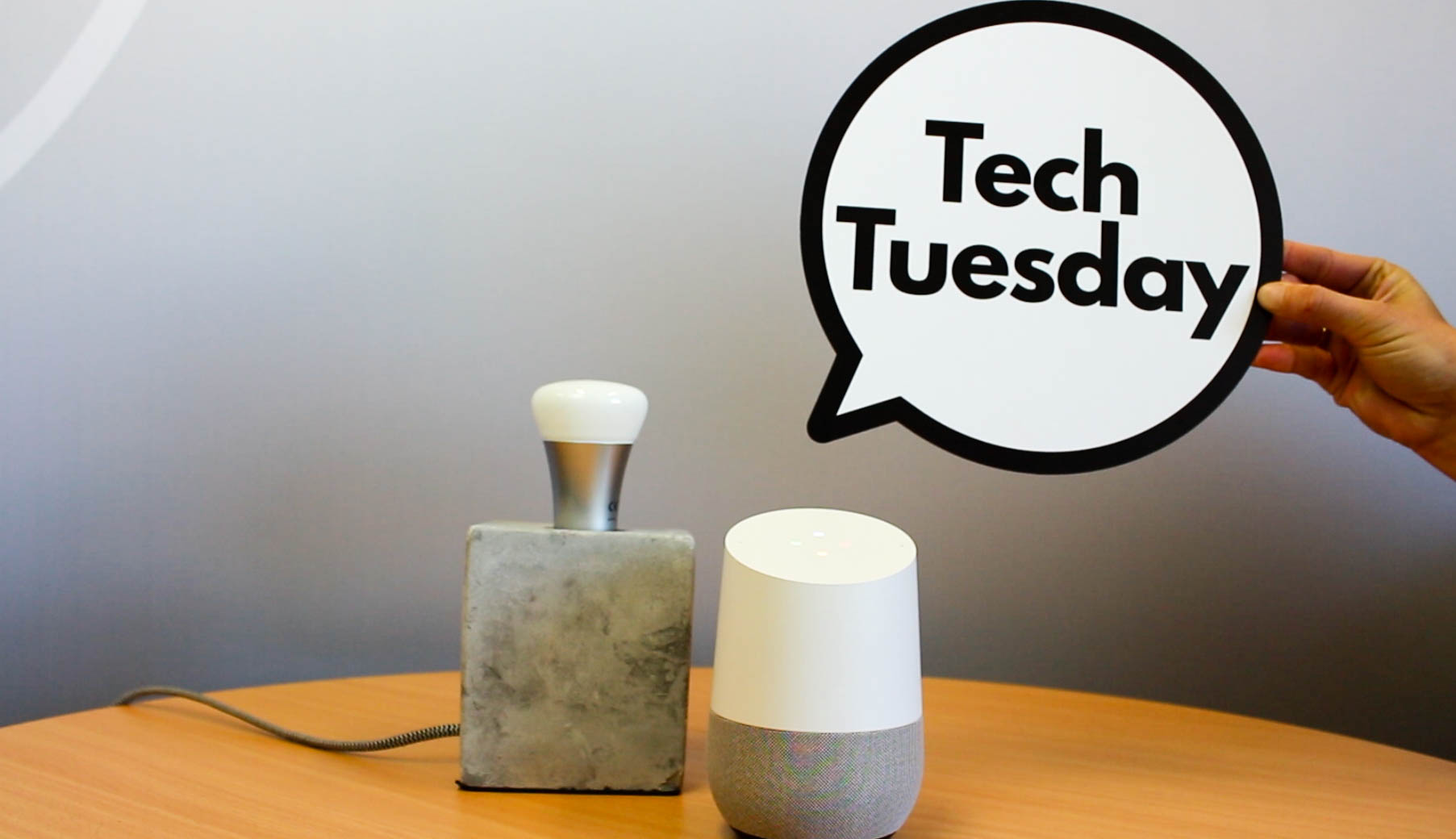 Google Home next to lamp with someone holding a speech bubble that reads Tech Tuesday