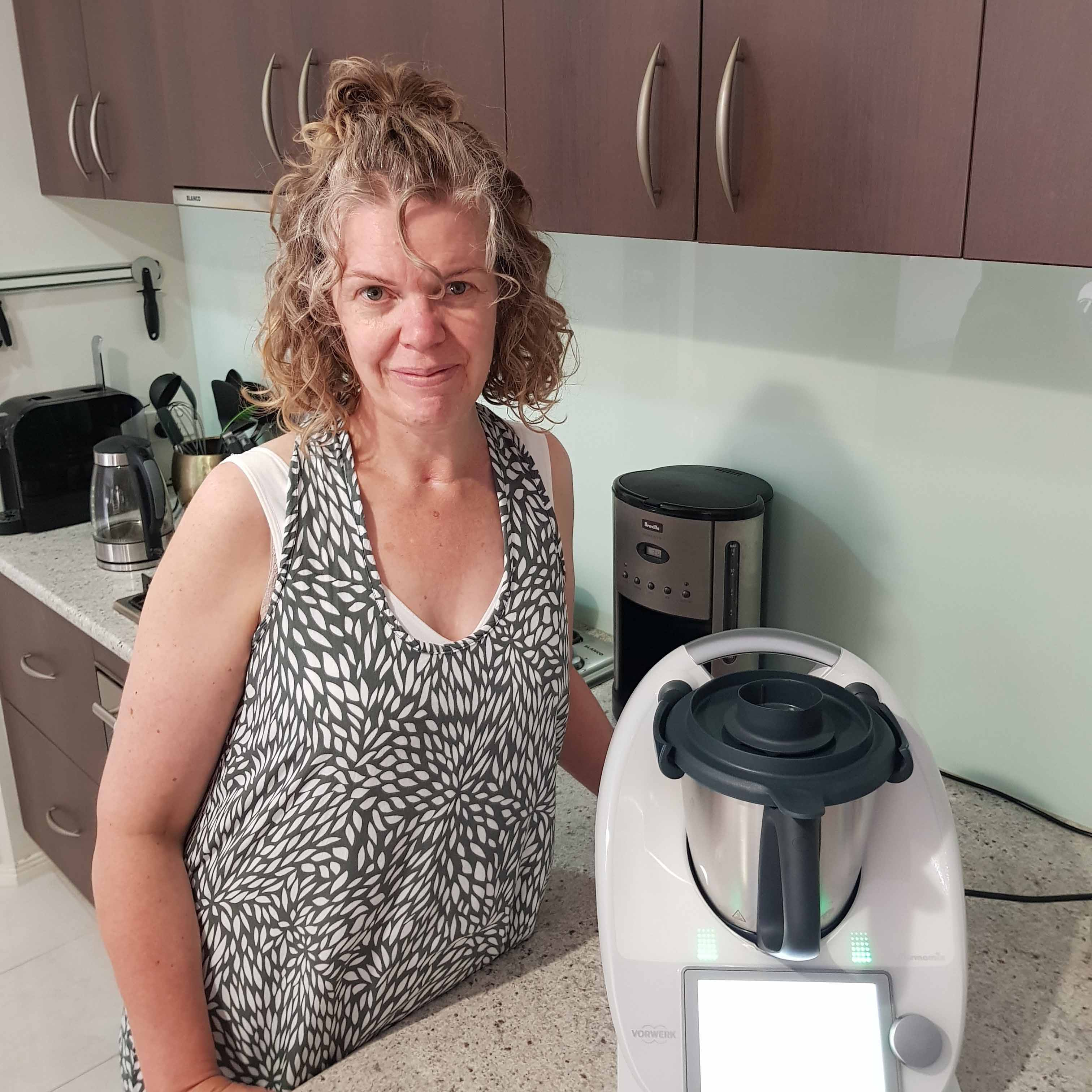 Lady standing beside her Thermomix